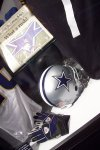 The game-worn helmet and gloves Emmitt wore when he broke the record