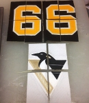 Mario Lemieux game-worn shoulder patch and number.