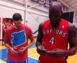 Austin Rivers and Quincy Acy sorting some 2012-13 NBA Hoops.