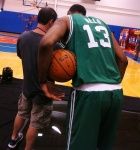 Fab Melo admiring the photography.