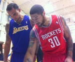 Robert Sacre and Royce White check out 2012-13 NBA Hoops.
