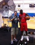 Terrence Ross checking out his photos.