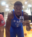 Perry Jones shows off his Draft Night card from 2012-13 NBA Hoops.